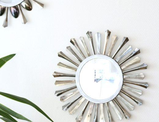 A super pretty DIY sunburst mirror created with disposable plastic cutlery!