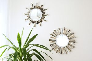 A super pretty DIY sunburst mirror created with disposable plastic cutlery!