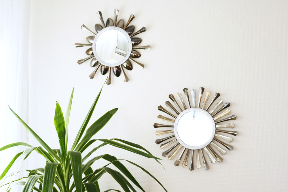 A super pretty sunburst mirror created with disposable plastic cutlery!